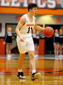 Tigers' Ryan Mendoza (11) dribbles the ball as the Barrington Broncos defeated the Crystal Lake Central Tigers 75-45 in a boys varsity basketball game on Monday, November 25, 2019, in Crystal Lake, Ill.
