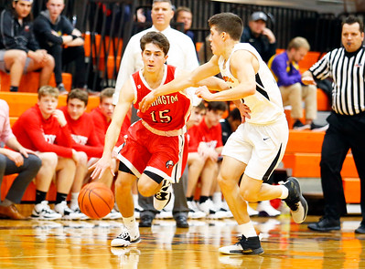 Broncos' Connor Groom (15) dribbles the ball as the Barrington Broncos defeated the Crystal Lake Central Tigers 75-45 in a boys varsity basketball game on Monday, November 25, 2019, in Crystal Lake, Ill.