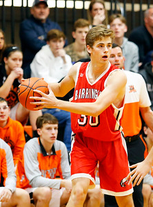 Broncos' Dylan Keenan (30) looks to pass as the Barrington Broncos defeated the Crystal Lake Central Tigers 75-45 in a boys varsity basketball game on Monday, November 25, 2019, in Crystal Lake, Ill.