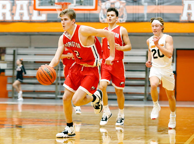Broncos' Will Grudzinski (32) dribbles as the Barrington Broncos defeated the Crystal Lake Central Tigers 75-45 in a boys varsity basketball game on Monday, November 25, 2019, in Crystal Lake, Ill.