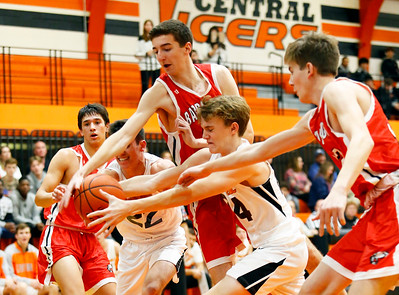 A scramble for a lose ball as the Barrington Broncos defeated the Crystal Lake Central Tigers 75-45 in a boys varsity basketball game on Monday, November 25, 2019, in Crystal Lake, Ill.