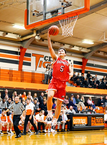 Broncos Damian Zivak (5) goes in for a layup as the Barrington Broncos defeated the Crystal Lake Central Tigers 75-45 in a boys varsity basketball game on Monday, November 25, 2019, in Crystal Lake, Ill.
