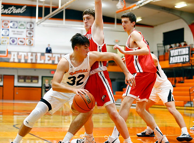 Tigers' Caleb Noennig (32) drives to the basket as the Barrington Broncos defeated the Crystal Lake Central Tigers 75-45 in a boys varsity basketball game on Monday, November 25, 2019, in Crystal Lake, Ill.