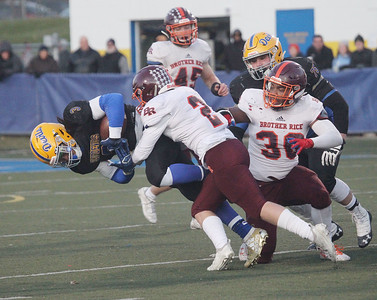 Candace H. Johnson-For Shaw Media Warren's Derrick McLaughlin gets tackled by Brother Rice's Mick Badke in the first quarter during the Class 8A state semifinals at Warren Township High School in Gurnee. Warren won 28-0. (11/23/19)