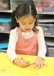 Candace H. Johnson-For Shaw Media Autumn Carbonel, 5, makes a hand turkey during the I Love Learning Preschool's Friendship Feast at the Grayslake Community Park District. (11/22/19)
