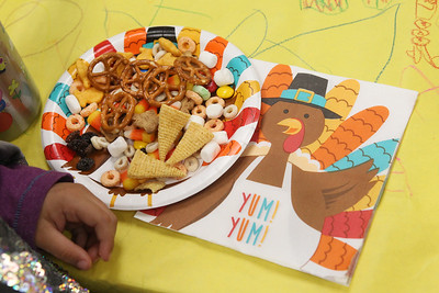 Candace H. Johnson-For Shaw Media Sophia Cordova, 4, enjoys some trail mix full of donated food from her classmates during the I Love Learning Preschool's Friendship Feast at the Grayslake Community Park District. The trail mix included pretzels, marshmallows, raisins, Bugles and more. (11/22/19)