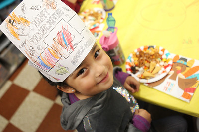Candace H. Johnson-For Shaw Media Sophia Cordova, 4, shows off the Happy Thanksgiving hat she made during the I Love Learning Preschool's Friendship Feast at the Grayslake Community Park District. (11/22/19)