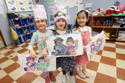 Candace H. Johnson-For Shaw Media Emma Allan, Tesslyn Edstrand-Ruotolo, both 4,  and Autumn Carbonel, 5, show the watercolor pilgrim pictures they made during the I Love Learning Preschool's Friendship Feast at the Grayslake Community Park District. (11/22/19)