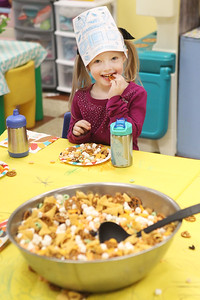 Candace H. Johnson-For Shaw Media Lylah Birdwell, 4, enjoys some trail mix made with donated food from her classmates during the I Love Learning Preschool's Friendship Feast at the Grayslake Community Park District. The trail mix for the feast included pretzels, marshmallows, Bugles and more. (11/22/19)