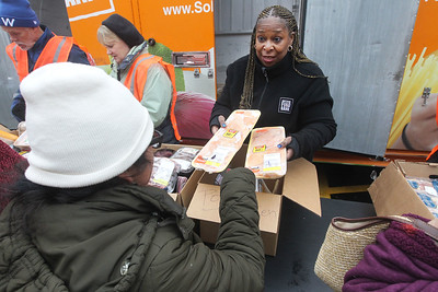 Candace H. Johnson-For Shaw Media Sharon McNeil, of Romeoville, manager of healthy community programs with the Northern Illinois Food Bank, hands out frozen meat to clients at the Rx Mobile Pantry at the Round Lake Library. The next pantry will arrive at the library on December 3rd from 12-2:00 pm. (11/19/19)