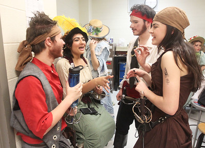 Candace H. Johnson-For Shaw Media Mason Szymczak, Selma Khwaja, both 17, Ethan Bader, 18, and Ashley Cheshier, 17, all of Wauconda and dressed as pirates have a moment to talk back stage before the start of The Pirates of Penzance at Wauconda High School. (11/21/19)
