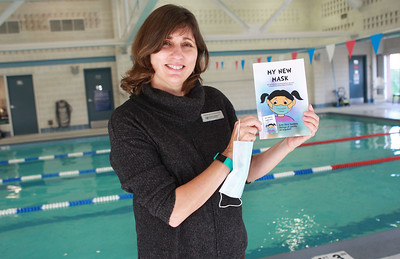 """Candace H. Johnson-For Shaw Media Christa Lawrence, marketing manager for the Mundelein Park & Recreation District, holds her new book titled, """"My New Mask,"""" next to the indoor pool at the Mundelein Community Center. Proceeds from the book benefit the Mundelein Parks Foundation. The book can be purchased at the community center or on Amazon for $10 each. (11/2/20)"""