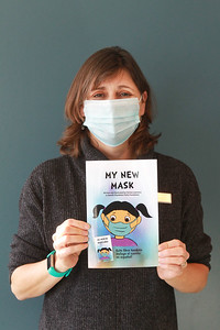 """Candace H. Johnson-For Shaw Media Christa Lawrence, marketing manager for the Mundelein Park & Recreation District, holds her new book titled, """"My New Mask,"""" at the Mundelein Community Center. Proceeds from the book benefit the Mundelein Parks Foundation.The story is told twice, once in English and once in Spanish.The book can be purchased at the community center or on Amazon for $10 each. (11/2/20)"""