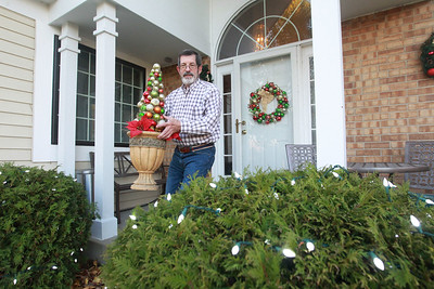 Candace H. Johnson-For Shaw Media Terry Weppler, mayor of Libertyville, puts up holiday lights and decorations outside of his home in Libertyville. The mayor encourages residents to go all out with holiday decorations this year for Light Up Lake County.  (11/4/20)