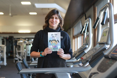 """Candace H. Johnson-For Shaw Media Christa Lawrence, marketing manager for the Mundelein Park & Recreation District, holds her new book titled, """"My New Mask,"""" on the fitness floor at the Mundelein Community Center. Proceeds from the book benefit the Mundelein Parks Foundation. The story is told twice, once in English and once in Spanish.The book can be purchased at the community center or on Amazon for $10 each. (11/2/20)"""