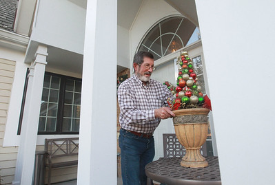 Candace H. Johnson-For Shaw Media Terry Weppler, mayor of Libertyville, puts up holiday decorations outside of his home in Libertyville. The mayor encourages residents to go all out with holiday decorations this year for Light Up Lake County.  (11/4/20)
