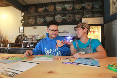 Candace H. Johnson-For Shaw Media Daos Perez, 16, of Antioch gets help from his mother, Daisy, owner, with a choice of crayons as he colors one of six art pages for Antioch's 1st Community Wall Mural Project-Honoring Our Local Heroes at Daisy's Artish Café in Lake Villa. The mural, which consists of 167 art pages, will be on display starting  December 7th at Kringle's Christmas Village in Antioch. The mural is sponsored by the Antioch Chamber of Commerce. (11/16/20)