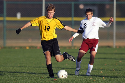 Sarah Nader - snader@shawmedia.com Marengo's Jake Piske (right) guards Harvard's William Rockcastle while he brings the ball down field during the second half of Monday's game in Marengo on October 8, 2012. Harvard won, 2-0.