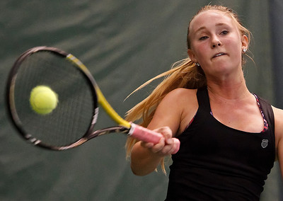 Brett Moist/ For the Northwest Herald  Belvidere North's Lindsay Kirkham-Olsen returns a volley Crystal Lake Central's Jenna Wallace during the IHSA Sectionals Final Round match at the Racket Club in Crystal Lake on Saturday. Jenna Wallace won the matchup 6-3, 6-1.