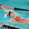 St. Charles East's Katie Nagler swims the 100-yard backstroke during a dual meet against St. Charles North Thursday. Nagler won the event.