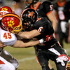 Batavia's Cullin Rokos (left) takes down Trevor Zajieck (5) during their game Friday night in St. Charles.