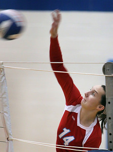 Jeff Krage – For the Northwest Herald Marian Central Catholic's Tara Blake spikes the ball during Monday's match at Rosary. Aurora 10/15/12