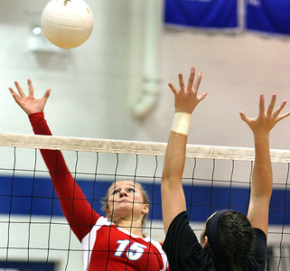 Jeff Krage - For the Northwest Herald Marian Central Catholic's Shannon Wuensch goes up for the ball during Monday's match at Rosary. Aurora 10/15/12