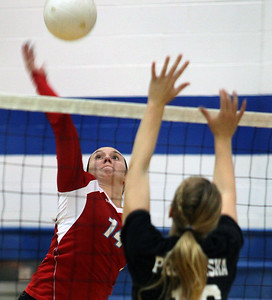 Jeff Krage – For the Northwest Herald Marian Central Catholic's Tara Blake goes up for a kill during Monday's match at Rosary. Aurora 10/15/12