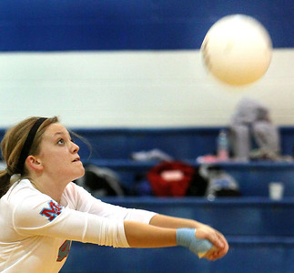 Jeff Krage - For the Northwest Herald Marian Central Catholic's Caitlin Brocker sets the ball during Monday's match at Rosary. Aurora 10/15/12