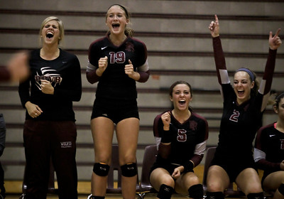 Josh Peckler - Jpeckler@shawmedia.com  Prairie Ridge's from left, Caitlin Brauneis, Ali Witt, Nicole Kirchberg and Kayla Carpentier celebrate match point after defeating Cary-Grove in three sets at Prairie Ridge High School Thursday, October 18, 2012.