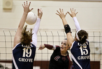 Josh Peckler - Jpeckler@shawmedia.com  Prairie Ridge's Kayla Carpentier (2) attempts to hit the ball past Cary-Grove blockers Mallory Wilczynski (19) and Jess Bartczyszyn (15) during the third set at Prairie Ridge High School Thursday, October 18, 2012.