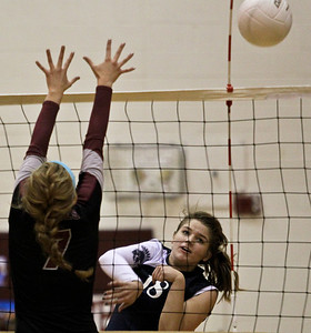 Josh Peckler - Jpeckler@shawmedia.com  Cary-Grove's Ally Vasquez attempts to hit the ball past Prairie Ridge's Morgan Lee during the first set at Prairie Ridge High School Thursday, October 18, 2012.
