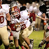 Anthonee Monson (32) of Morris carries the ball during their game at Kaneland Friday night.