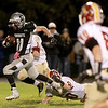 Zack Martinelli of Kaneland runs for a touchdown during the first half of their home game against Morris Friday night.