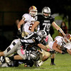 Collin Grogan of Morris carries the ball during their game at Kaneland Friday night.