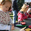 Jeff Krage – For the Kane County Chronicle<br /> Kathleen Cerwin (left), 5, of North Aurora works on her drawing during Saturday's BatFest in downtown Batavia.<br /> Batavia 10/20/12