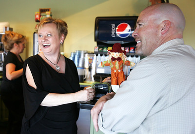 Monica Maschak - mmaschak@shawmedia.com Kim Ribar, owner of Kim and Patty's Cafe, shares a laugh with food representative Mike Calhan in the McHenry restaurant Wednesday.  Ribar, who has taken over sole ownership of the Cafe, has been waitressing for 31 years.