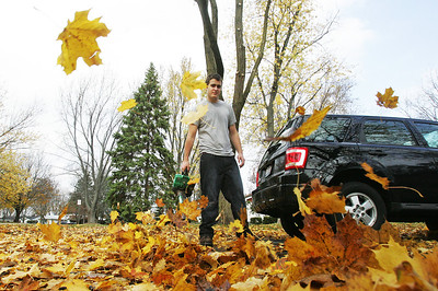 H. Rick Bamman - hbamman@shawmedia.com Evan Vining of the 300 block of Mary Lane in Crystal Lake uses a leaf blower to clear his driveway Wednesday, October 24, 2012. For the second day, temperatures are expected in the 70's with a chance for rain Thursday afternoon.