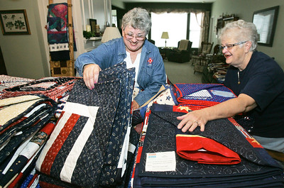 H. Rick Bamman - hbamman@shawmedia.com Gazebo Quilters of Huntley members Jan Meyer, (left) and Sue Bruss prepare some of the 80 quilts for veterans in Meyer's Huntley home Thursday, October 25, 2012. The group plans to present the red white and blue quilts to area veterans on Saturday. Gazebo Quilters of Huntley represents the local branch of the Quilts of Valor national organization.