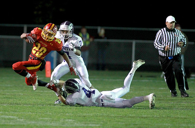 Batavia's Anthony Scaccia (28) runs with the ball during their first-round playoff game against Downers Grove North Friday night in Batavia.