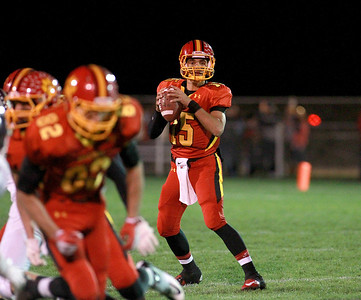 Batavia quarterback Micah Coffey looks to make a pass during their first-round playoff game against Downers Grove North Friday night in Batavia.