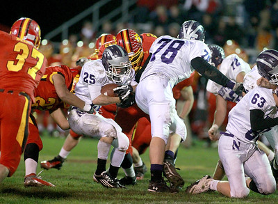 Kyle Leto (25) of Downers Grove North runs with the ball during their first-round playoff game North Friday night in Batavia.