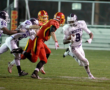 Vontae Diggs of Downers Grove North runs with the ball during their first-round playoff game North Friday night in Batavia.