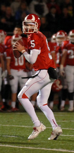 Hinsdale Central's Brian Owens passes the ball during their home game against Oak Park River Forest Friday October 26, 2012.  Staff photo by Erica Benson
