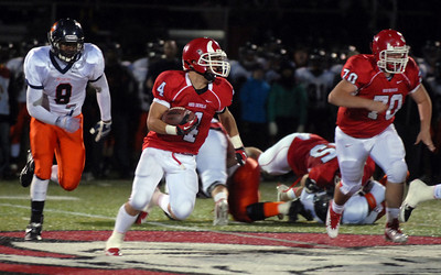 Hinsdale Central's Jack Adams fields the ball during their home game against Oak Park River Forest Friday October 26, 2012.  Staff photo by Erica Benson