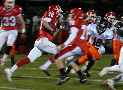 Hinsdale Central's Chase Hamiliton fields the ball during their home game against Oak Park River Forest Friday October 26, 2012.  Staff photo by Erica Benson