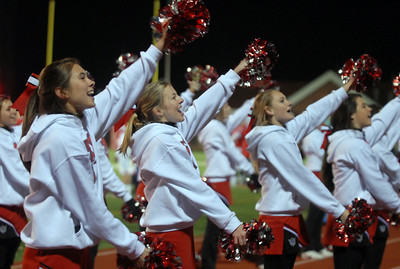 Hinsdale Central's cheerleaders encourage their fans during their home game against Oak Park River Forest Friday October 26, 2012.  Staff photo by Erica Benson