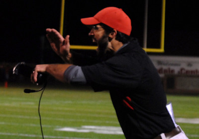 Hinsdale Central's defensive coach sets up a play during their home game against Oak Park River Forest Friday October 26, 2012.  Staff photo by Erica Benson
