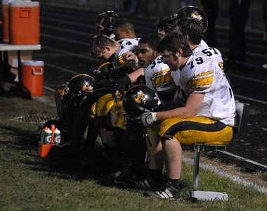 Hinsdale South players sit in silence on the sideline late in the fourth quarter of a 29-0 playoff loss at Oak Forest on Friday, Oct. 26, 2012. Staff photo by Matthew Piechalak  |  Buy this photo at snapshots.mysuburbanlife.com/1557279