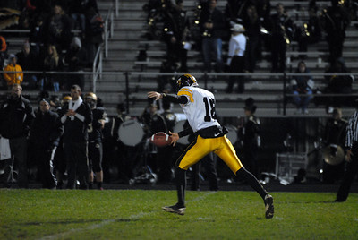 Hinsdale South junior Joey Jablonski (18) punts the ball away during a playoff game at Oak Forest on Friday, Oct. 26, 2012. Staff photo by Matthew Piechalak  |  Buy this photo at snapshots.mysuburbanlife.com/1557279